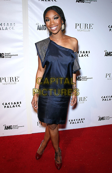 BRANDY (Brandy Norwwod).Ray J celebrates his 30th birthday at Pure Nightclub inside Caesar's Palace Resort Hotel and Casino, Las Vegas, Nevada, USA, 15th January 2011..full length blue one shoulder dress silk satin navy gold bracelets tattoos off the .CAP/ADM/MJT.© MJT/AdMedia/Capital Pictures.