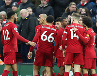 1st February 2020; Anfield, Liverpool, Merseyside, England; English Premier League Football, Liverpool versus Southampton; Alex Oxlade-Chamberlain of Liverpool celebrates with his team mates after scoring the opening goal after 47 minutes