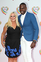 Vanessa Feltz and husband Ben arriving for the Health Lottery Tea Party, The Savoy, London. 02/06/2014 Picture by: Alexandra Glen / Featureflash