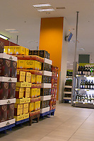The interior of Systembolaget, the Swedish retail monopoly stores for alcohol wine beer spirits with bag in box cartons with wine displayed on pallets Stockholm, Sweden, Sverige, Europe