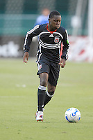 DC United midfilder Freddy Adu (9) controls the ball during the game. The Chicago Fire defeated DC United 3-2, Sunday, October 15, 2006, at RFK Stadium.