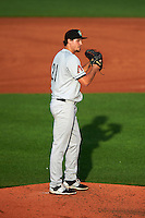 Kane County Cougars pitcher Josh Taylor (21) gets ready to deliver a pitch a game against the Cedar Rapids Kernels on August 18, 2015 at Perfect Game Field in Cedar Rapids, Iowa.  Kane County defeated Cedar Rapids 1-0.  (Mike Janes/Four Seam Images)