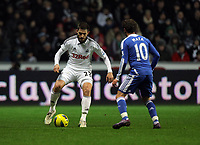 Pictured L-R: Angel Rangel of Swansea against Juan Mata of Chelsea. Tuesday, 31 January 2012<br />
