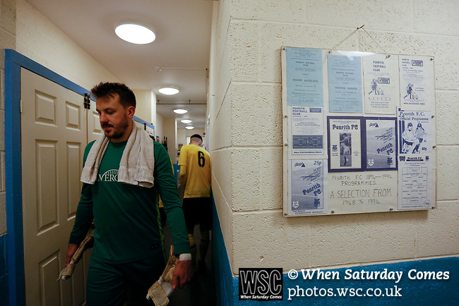 Hebburn's Andrew Jennison emerges for the second half, next to a selection of framed Penrith programmes. Penrith AFC V Hebburn Town, Northern League Division One, 22nd December 2018. Penrith are the only Cumbrian team in the Northern League. All the other teams are based across the Pennines in the north east.<br />