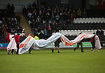 Groundsmen taking away an advertising sign on the pitch at the Paisley2021 Stadium before Scottish Championship side St Mirren played Welsh champions The New Saints in the semi-final of the Scottish Challenge Cup for the right to meet Dundee United in the final. The competition was expanded for the 2016-17 season to include four clubs from Wales and Northern Ireland as well as Scottish Premier under-20 teams. Despite trailing at half-time, St Mirren won the match 4-1 watched by a crowd of 2044, including 75 away fans.