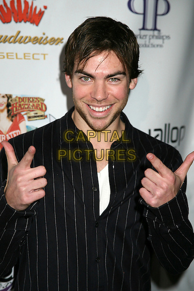 "DAVID WACHS .""The Dukes of Hazzard: The Beginning"" DVD Release Party at Forbidden City, Hollywood, California, USA..March 21st, 2007.half length black pinstripe fingers pointing hands .CAP/ADM/BP.©Byron Purvis/AdMedia/Capital Pictures"