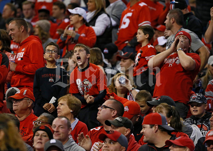 Young Ohio State Buckeyes fans cheer for their team during the second quarter of the Big Ten championship football game against the Wisconsin Badgers at Lucas Oil Stadium in Indianapolis on Dec. 2, 2017. [Adam Cairns / Dispatch]
