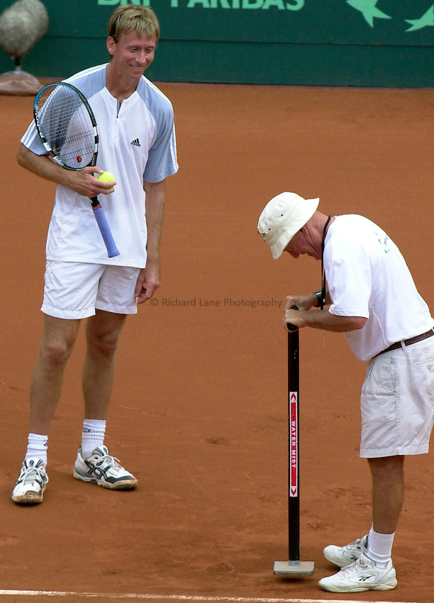 Photo. Steve Holland.Davis Cup Tennis 2003.Sunday 9 Febuary 2003.Australia V Great Britain.Wayne Arthurs watches as the court is repaired during his singles match against Miles Maclagan
