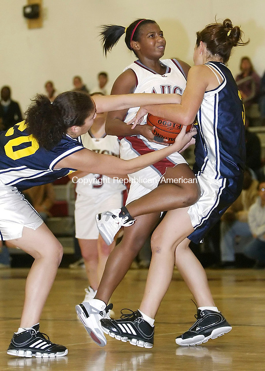 NAUGATUCK, CT 12/18/07- 121807BZ10- Naugatuck's Jessica Webber (31) tries to get through the defense of Kennedy's Kasiana Goodman (20) and Deborah Rosado (31) during their game at Naugatuck High School Tuesday. <br /> Jamison C. Bazinet Republican-American