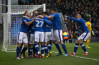 Oldham Athletic's Cameron Dummigan celebrates scoring his side's first goal with team mates during the Sky Bet League 1 match between Oldham Athletic and Rochdale at Boundary Park, Oldham, England on 18 November 2017. Photo by Juel Miah/PRiME Media Images