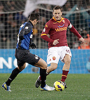 Calcio, semifinale di andata di Coppa Italia: Roma vs Inter. Roma, stadio Olimpico, 23 gennaio 2013..AS Roma forward Francesco Totti is challenged by FC Inter defender Javier Zanetti, of Argentina, during the Italy Cup football semifinal first half match between AS Roma and FC Inter at Rome's Olympic stadium, 23 January 2013..UPDATE IMAGES PRESS/Riccardo De Luca