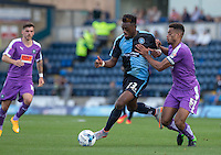 Gozie Ugwu of Wycombe Wanderers  holds off Curtis Nelson of Plymouth Argyle during the Sky Bet League 2 match between Wycombe Wanderers and Plymouth Argyle at Adams Park, High Wycombe, England on 12 September 2015. Photo by Andy Rowland.