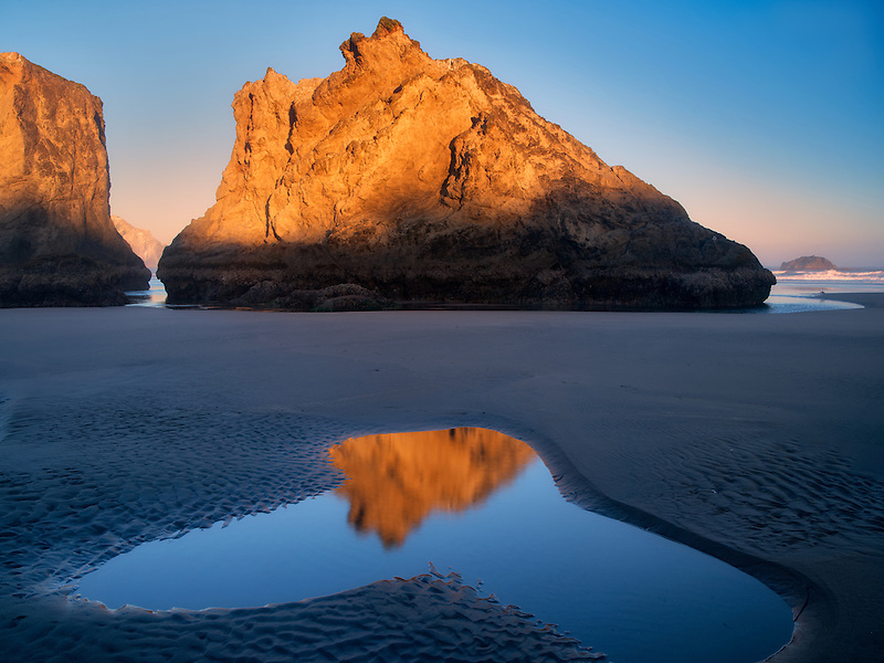 Low tide pools reflecting seastack at sunrise. Bandon Beach. Oregon
