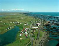 Stokkseyri, Eyjafjallajökull í baksýn. Stokkseyri, viewing east to Eyjafjallajokull glacier. Árborg frá 1998 / Arborg since 1998.
