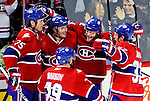 10 February 2010: Montreal Canadiens celebrate a goal against the Washington Capitals at the Bell Centre in Montreal, Quebec, Canada. The Canadiens defeated the Capitals 6-5 in sudden death overtime, ending Washington's team-record winning streak at 14 games. Mandatory Credit: Ed Wolfstein Photo