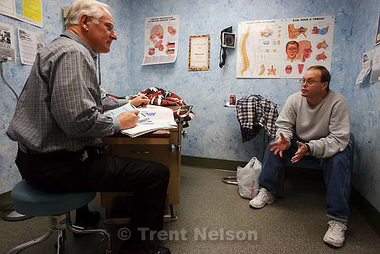 Salt Lake City - The Fourth Street Clinic, a community health clinic, is operating at capacity, having to turn away between fifteen and twenty patients a day. Dr. Dennis Harston examined a patient Tuesday December 9, 2008.