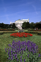 Beautiful flowers and Hofburg Imperial Palace in the old town of Vienna Austria