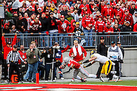 Ohio State Buckeyes wide receiver Devin Smith (9) dives into the end zone during the 3rd quarter during Saturday's game in Columbus, Ohio on Saturday, Oct. 19, 2013. (Jabin Botsford / The Columbus Dispatch)