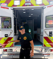 NWA Democrat-Gazette/JASON IVESTER <br /> Lowell Fire Cpt. Jason Elam opens the department's new abulance on Tuesday, Aug. 25, 2015, from the station. The department plans to have the ambulance in service beginning Jan. 1, 2016.