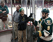 Steve Basiel (UVM - Athletic Trainer), Charlie Mackey (UVM - Equipment Manager), Jack Lyman (UVM), Kyle Reynolds (UVM - 9) - The Boston College Eagles defeated the visiting University of Vermont Catamounts to sweep their quarterfinal matchup on Saturday, March 16, 2013, at Kelley Rink in Conte Forum in Chestnut Hill, Massachusetts.