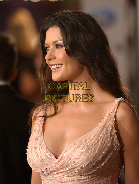 "CATHERINE ZETA-JONES.The Warner Brothers' World Premiere of ""Ocean's Twelve"" held at The Grauman's Chinese Theatre in Hollywood, California .December 8th,2 004.headshot, portrait, light pink top, plunging neckline.www.capitalpictures.com.sales@capitalpictures.com.Supplied By Capital PIctures"