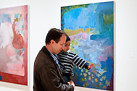 Man and child viewing art at University of Washington Master of Fine Art Thesis exhibition. Photograph biy Robert Wade.