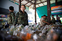 Thai army patroling a local market, that are frequently attacked by insurgents. Thailand is struggling to keep up appearances as the land of smiles has to face up to its troubled south. Since 2004 more than 3500 people have been killed and 4000 wounded in a war we never hear about. In the early hours of January 4th 2004 more than 50 armed men stormed a army weapons depot in Narathiwat taking assault rifles, machine guns, rocket launchers, pistols, rocket-propelled grenades and other ammunition. Arsonists simultaneously attacked 20 schools and three police posts elsewhere in Narathiwat. The raid marked the start of the deadliest period of armed conflict in the century-long insurgency. Despite some 30,000 Thai troops being deployed in the region, the shootings, grenade attacks and car bombings happen almost daily, with 90 per cent of those killed being civilians. 23.09.07. Photo: Christopher Olssøn