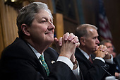 UNITED STATES - SEPTEMBER 27: Sen. John Kennedy, R-La., listens to Judge Brett Kavanaugh during the Senate Judiciary Committee hearing on his nomination be an associate justice of the Supreme Court of the United States, focusing on allegations of sexual assault by Kavanaugh against Christine Blasey Ford in the early 1980s. (Photo By Tom Williams/CQ Roll Call)