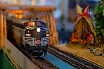 Dec. 26, 2012 - Garden City, New York, U.S. - The Long Island Garden Railway Society large-scale model train display is a festive winter holiday attraction in the vast 3-floor atrium of Cradle of Aviation museum, until shortly after New Years Day 2013. At this part of display, a G-scale New York Central engine passes through a wood tressel by an Indian teepee. LIGRS shares the knowledge, fun, and camaraderie of large-scale railroading both indoors and in the garden, and is family oriented.