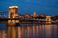 Budavári Palota - Budapest castle sits on hill above Széchenyi lánchíd - Széchenyi Chain Bridge and Danube river at night, Budapest, Hungary