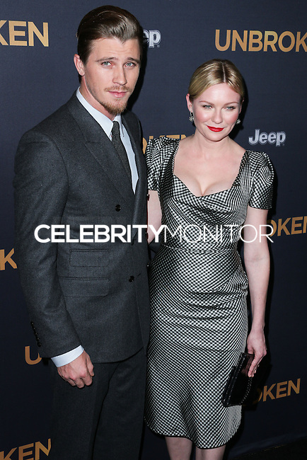 HOLLYWOOD, LOS ANGELES, CA, USA - DECEMBER 15: Garrett Hedlund, Kirsten Dunst arrive at the Los Angeles Premiere Of Universal Pictures' 'Unbroken' held at the Dolby Theatre on December 15, 2014 in Hollywood, Los Angeles, California, United States. (Photo by Xavier Collin/Celebrity Monitor)