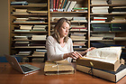 April 29, 2018; Elaine Stratton Hild a NDIAS Fellow looks over manuscripts at the Medieval Institute in Hesburgh Library.  (Photo by Barbara Johnston/University of Notre Dame)