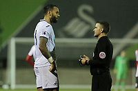 Pictured: Kyle Bartley is spoken to by match referee Savva Yianni. Wednesday 20 December 2017<br /> Re: Premier League International Cup, Swansea City U23 v Athletic Bilbao at the Landore Training Ground, Swansea, Wales, UK.