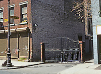 New York City: Patchin Place, entrance. Greenwich Village. Note: the open sides give free access but indicate privacy. Photo '78.