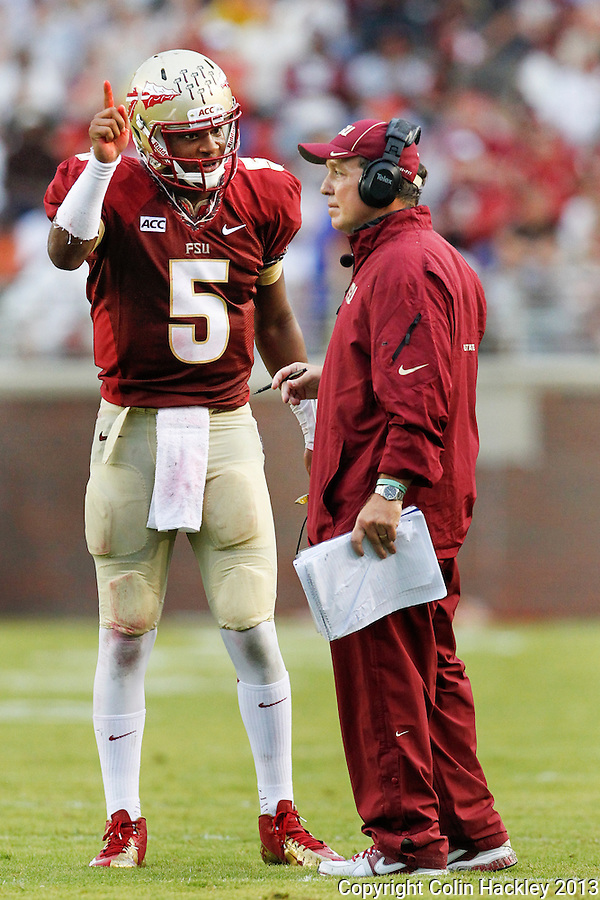 TALLAHASSEE, FLA 9/21/13-FSU-BCC092113CH-Florida State quarterback Jameis Winston, left, talks with Head Coach Jimbo Fisher during a first half break in the Bethune-Cookman game Saturday at Doak Campbell Stadium in Tallahassee. <br /> COLIN HACKLEY PHOTO