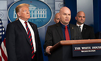 United States President Donald J. Trump listens to Arturo Del Cueto, National Spokesperson, National Border Patrol Council speak about border security in the White House briefing room in Washington, DC, January 3, 2019. <br /> CAP/MPI/RS<br /> &copy;RS/MPI/Capital Pictures