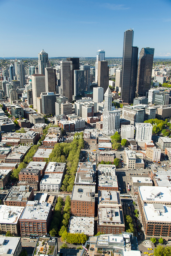 aerial photo of the construction site at 200 Occidental Ave. S. in Seattle, with downtown skyline, waterfront, Elliott Bay, Century Link Field, and the SODO neighborhood