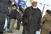 An elderly Bangladeshi man walks through Whitechapel Market, in the London Borough of Tower Hamlets.