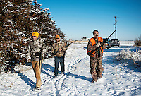 From left, OutdoorLife Editor Andrew McKean (cq), Web Editor for Ducks Unlimited Chris Jennings (cq), and NO NAME search for pheasant on a hunting trip near Grand Island, Nebraska, Sunday, December 4, 2011. ..Photo by Matt Nager