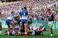 The Warriors celebrate the Solomone Kata try. Sydney Roosters v Vodafone Warriors, NRL Rugby League. Allianz Stadium, Sydney, Australia. 31st March 2018. Copyright Photo: David Neilson / www.photosport.nz