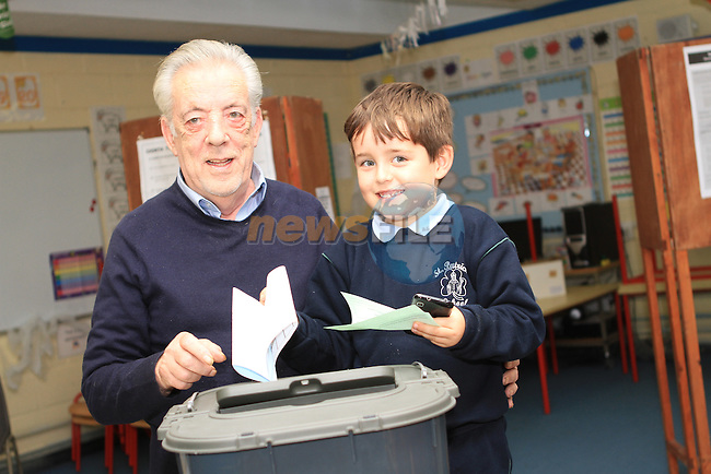 Alex Reynolds helps his granddad Oscar Reynolds as he votes for the Presidential Election at St Brigids NS, Bothar Brugha...(Photo credit should read Jenny Matthews www.newsfile.ie)....This Picture has been sent you under the conditions enclosed by:.Newsfile Ltd..The Studio,.Millmount Abbey,.Drogheda,.Co Meath..Ireland..Tel: +353(0)41-9871240.Fax: +353(0)41-9871260.GSM: +353(0)86-2500958.email: pictures@newsfile.ie.www.newsfile.ie.