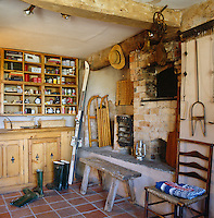 The original entrance hall to the cottage houses the old brick bread oven and has been turned since into a boot room and general storage area
