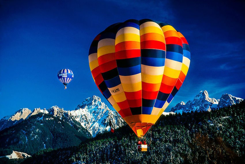 Hot air balloons flying during the International Hot Air Balloon Week, Chateau d'Oex, Switzerland