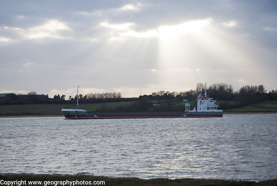 Hestia cargo ship on the River Orwell passing Shotley, Suffolk, England