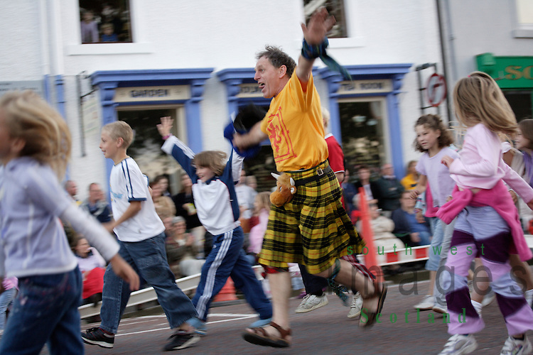Kirkcudbright Tattoo Scotland UK kids havning fun before the main event