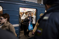 Moscow, Russia, 30/03/2010..Extra police stand guard inside Park Kultury metro station where a female suicide bomber blew herself up the previous day. At least 39 people were killed and 80 injured in the double blasts at Moscow metro stations during the morning rush hour.