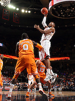 Virginia forward Akil Mitchell (25) shoots over Tennessee center Yemi Makanjuola (0) during the game Wednesday in Charlottesville, VA. Virginia defeated Tennessee 46-38.