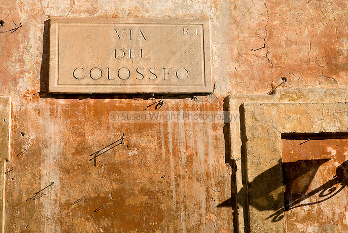 Via Del Colosseo sign on old facade of building, Rome Italy