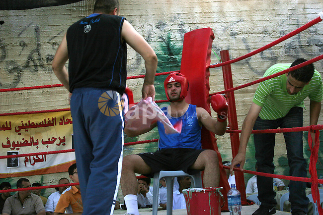 Palestinian players participate in a boxing match in the West Bank city of Hebron on August 6,2010. The players came from the different occupied West Bank cities. Photo by Mamoun Wazwaz