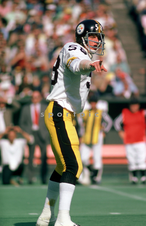 Pittsburgh Steelers Jack Lambert (58) in action during a game from his 1975 season with the Pittsburgh Steelers. Jack Lambert played for 11 years, all with the Pittsburgh Steelers  was a 9-time Pro Bowler  and was inducted to the Pro Football Hall of Fame in 1990.(SportPics)